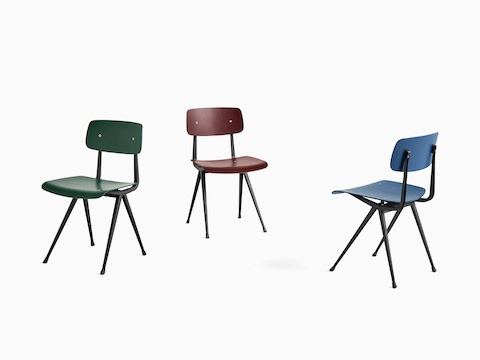 Green, red, and blue Result Chairs with black frames, viewed from various angles.