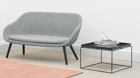 Black Tray Coffee Table alongside a gray About A Lounge Sofa.