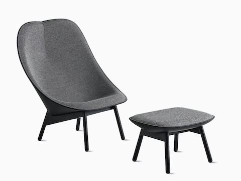 Grey Uchiwa Lounge Chair and Ottoman with black painted oak bases, viewed at an angle.