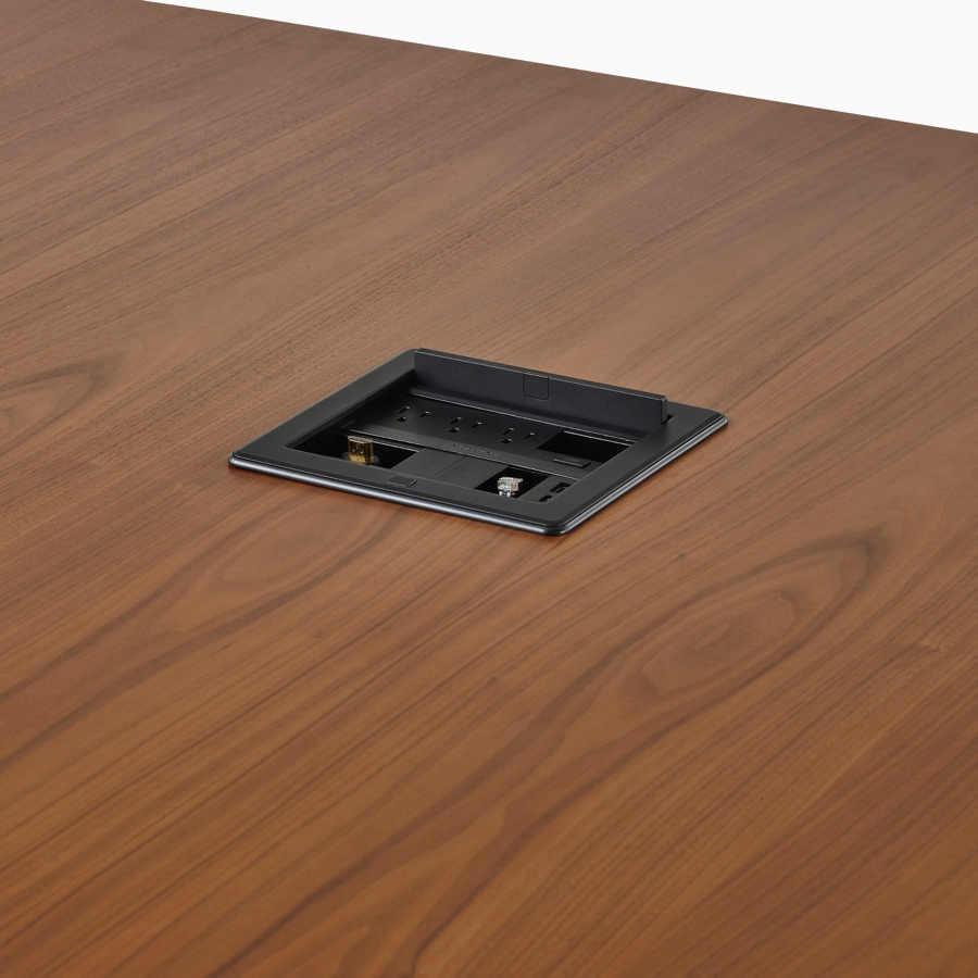 A close-up view of a Crestron unit in the surface of a Headway conference table.