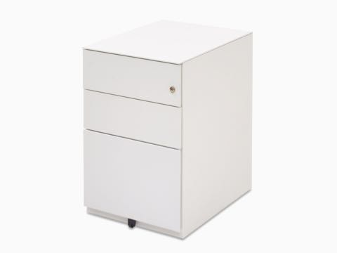 Angled view of a white Kumi pedestal with two box drawers and one file drawer.