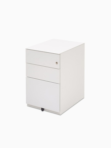 Angled view of a white pedestal with three drawers. Select to go to the Herman Miller Storage product page.