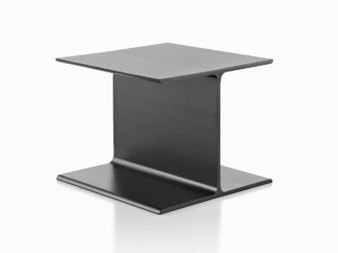 An angled view of a cast aluminum I Beam occasional table with a bare top.