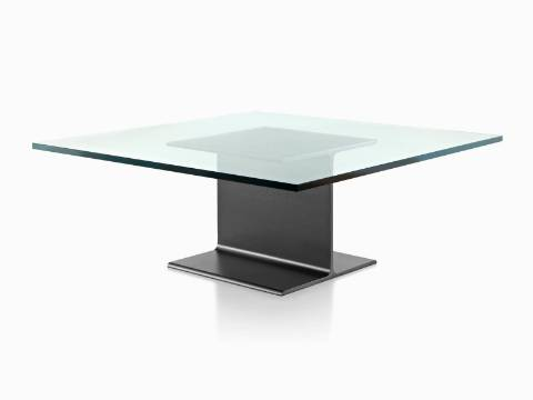 An angled view of a cast aluminum I Beam occasional table with a glass top.