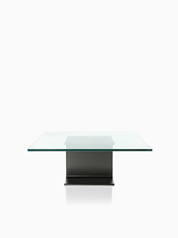 A square I Beam Table with a glass top.