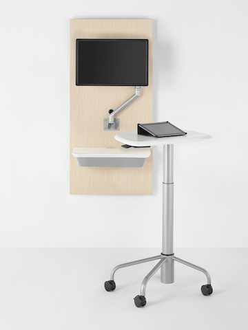 A tablet computer sits atop a mobile Intent Solution table, which is detached from the companion wall unit.
