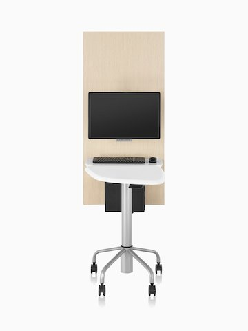 A table and wall unit that support patient interaction and technology.