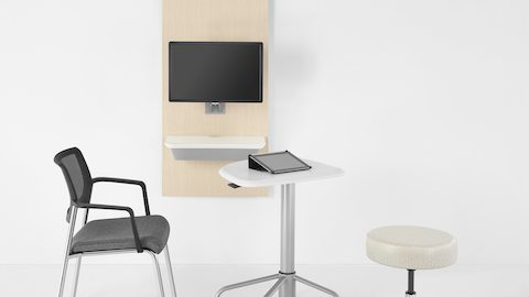 The mobile Intent Solution table pulled away from the wall unit to facilitate interaction between caregiver and patient.