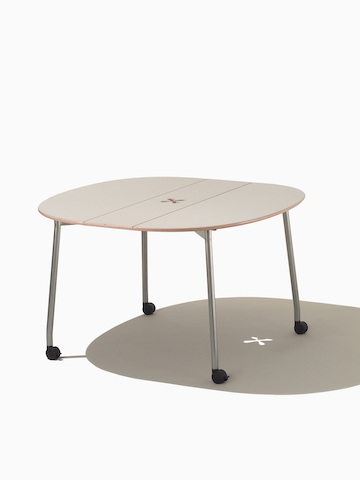 A round Intersect Table with a beige top.