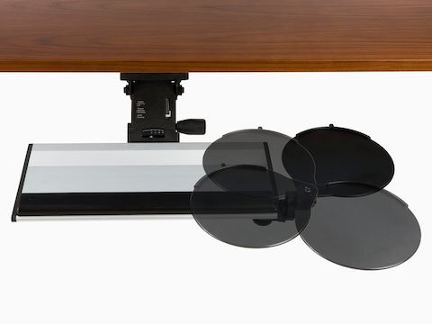 A Keyboard Support extends out from beneath a work surface, with the attached mouse platform positioned at four angles.