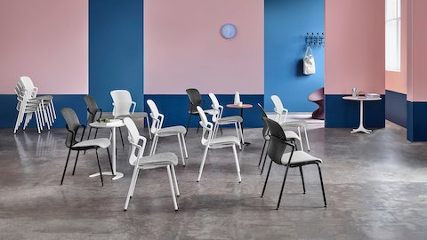 Black and white Keyn stackable side chairs in a training environment.