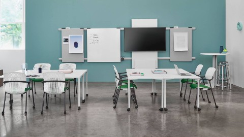 White Keyn side chairs with green seats in a training room.