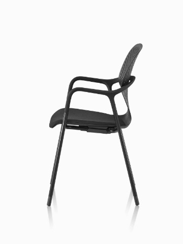 Side view of a stackable black Keyn side chair with a four-leg base.