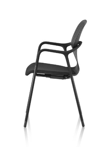 Profile view of a stackable black Keyn side chair with a four-leg base.