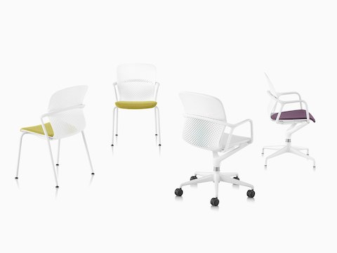 Four white, yellow, and purple Keyn chairs with five-star, four-leg, and four-star bases, viewed from side, front, and 45-degree angles.