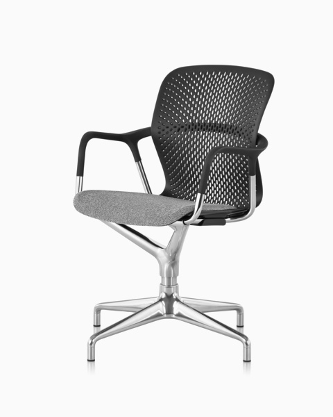 Black Keyn side chair with a gray fabric seat and polished four-star base, viewed from an angle.