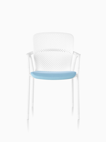 White Keyn side chair with a blue seat, viewed from the front.