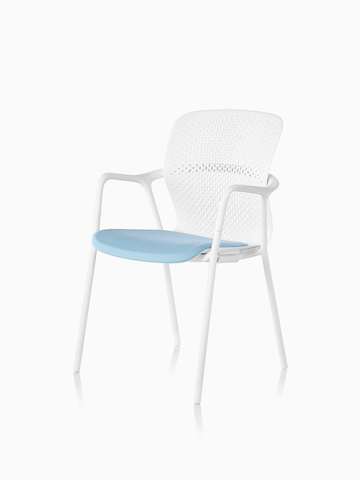White Keyn side chair with a blue seat. Select to go to the Keyn Chair Group product page.