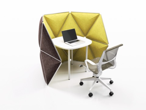 Triangular Kivo tiles in yellow fabric define a small workstation containing a table and gray Setu office chair.