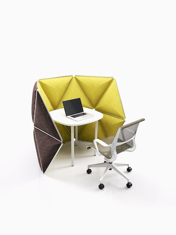 Kivo tiles form the boundary of a partially enclosed workstation. Select to go to the Kivo product page.