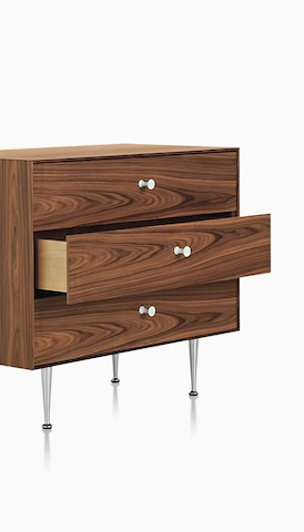 A Nelson Thin Edge chest with three drawers in a medium wood finish. Select to go to the Herman Miller storage landing page.