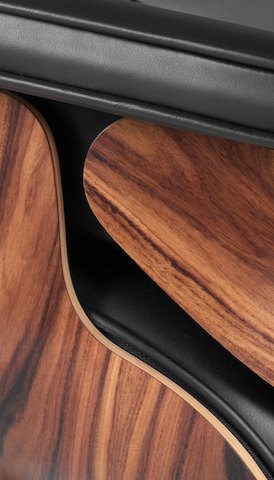 Close view of the design detail on an Eames Lounge Chair. Select to go to the Herman Miller Collection landing page.