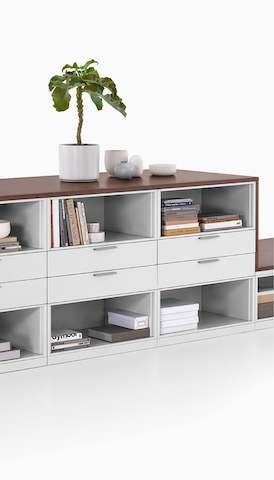 A Meridian Storage unit with open shelves and drawers. Select to go to the Herman Miller storage landing page.
