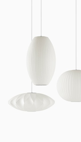 Hanging Nelson Bubble Lamps of three different shapes. Select to go to the Herman Miller accessories landing page.
