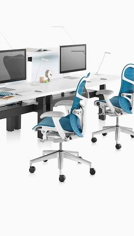 Two blue Mirra 2 office chairs in a benching application. Select to go to the Herman Miller workspaces landing page.