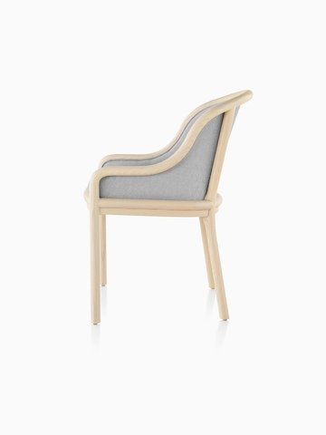 Landmark Chair with light gray upholstery and a light wood frame, viewed from the side.