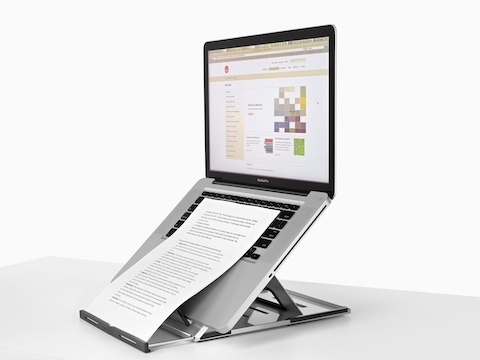 Lapjack Mobile Technology Support holds a notebook computer and sheet of paper at a comfortable viewing angle.