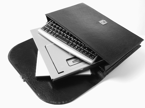 Lapjack Mobile Technology Support, folded flat, joins a keyboard and notebook computer in a briefcase.