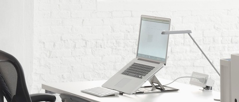 An open notebook computer positioned at a comfortable viewing angle with the help of Lapjack Mobile Technology Support.