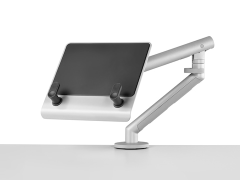 An adjustable Flo Monitor Arm supports an empty Laptop Mount, which has two brackets to hold a notebook computer.