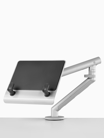 A surface-attached Laptop Mount holding a notebook computer. Select to go to the Laptop Mount product page.