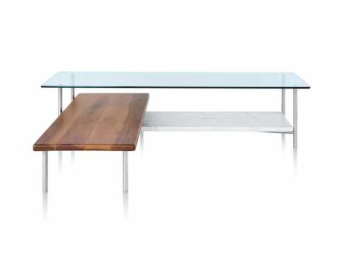 A glass top L-shaped Layer coffee table with two wood lower shelves.