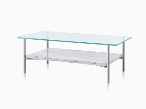 An angled view of a rectangular Layer occasional table with a glass top and stone lower surface.