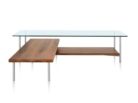 An L-shaped Layer glass top coffee table with two wood lower shelves.