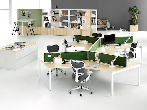 Angled Layout Studio workstations with green dividing screens, Gray Mirra 2 Chairs, and green dividing screens near lateral file storage.