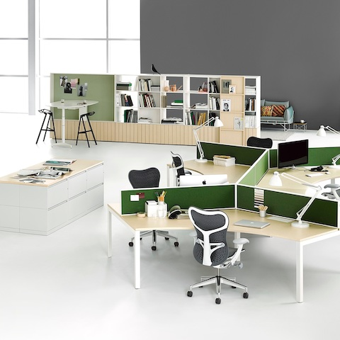 A workspace with two 120-degree Layout Studio workstations with privacy screens and Mirra 2 Chairs, lateral files, and Locale storage and bookcase.
