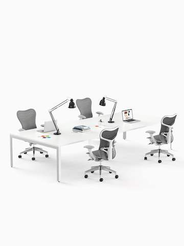 White, rectangular Layout Studio meeting tables and gray Mirra 2 office chairs.