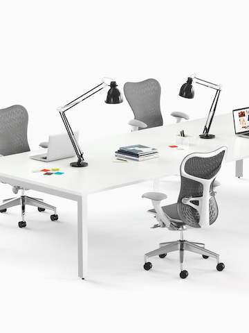 White, rectangular Layout Studio meeting tables and gray Mirra 2 office chairs. Select to go to the Layout Studio product page.