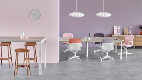 A standing-height Layout Studio table with Crosshatch Stools is outside a meeting room. The meeting room features a Layout Studio table, Keyn Chairs, and a Layout Studio credenza.