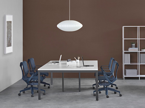 Office setting with a Layout Studio four-person bench and dark blue Cosm chairs.