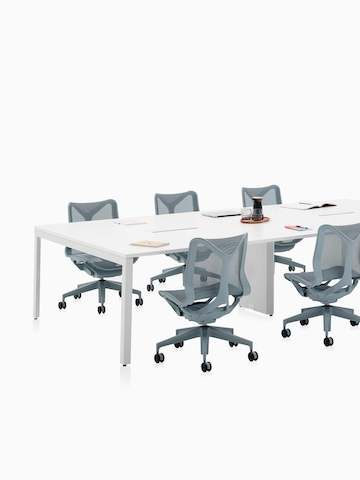 Six-person Layout Studio meeting table with gray low-back Cosm Chairs.