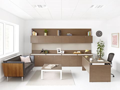 A private office with a Layout Studio desk perpendicular to a wall of Layout Studio overhead and base storage.