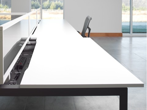 A linear Layout Studio work surface with the top slid open for easy access to power and data.
