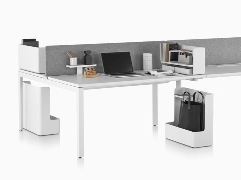 A linear Layout Studio work surface with a gray privacy screen and various Ubi Work Tools to aid organization.