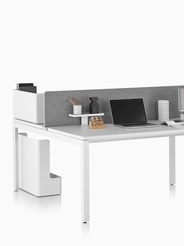 A Layout Studio work surface with a grey privacy screen. Select to go to the Layout Studio product page.