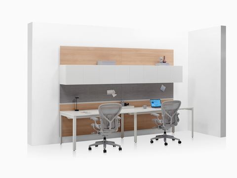 Layout Workwall with whiteboard cupboards, two Layout Studio desks, and two light grey Aeron Chairs.